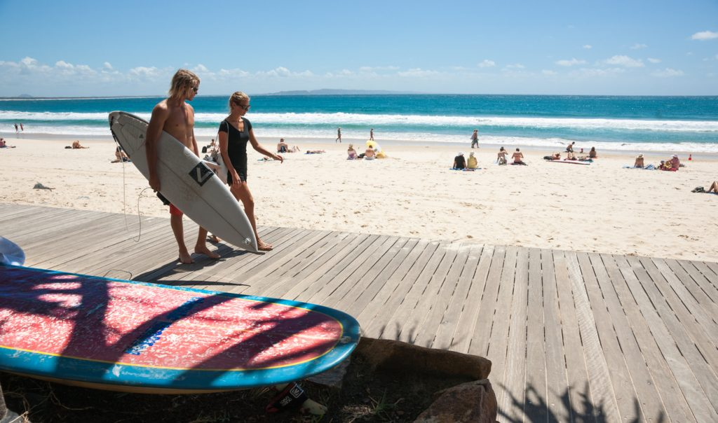 Surfers, walking and talking, Noosa, Queensland, Australia