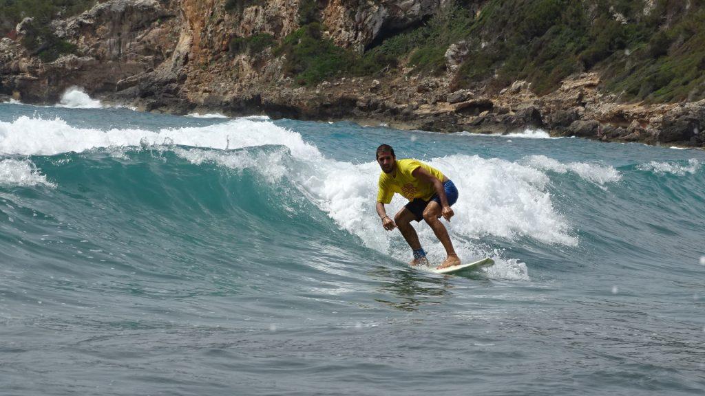 Surfing in Canyamel, Majorca, Spain
