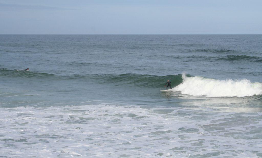 Surfers riding waves at Daytona Beach Florida