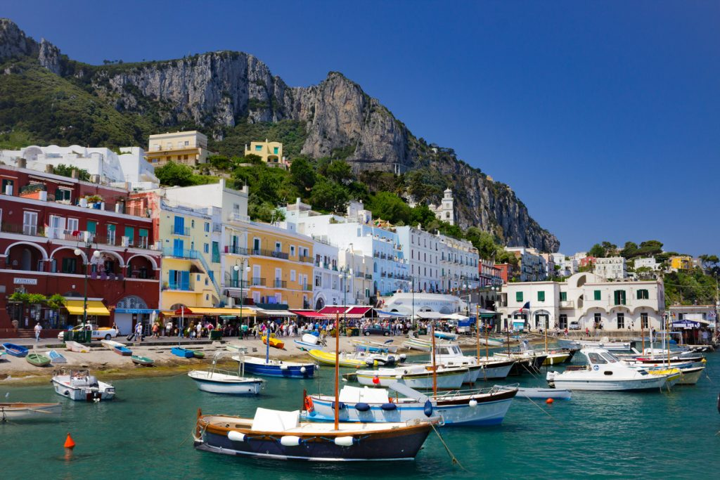 This is the island of Capri as you enter it from the main ferry from Sorrento, Italy. The view is stunning with all it's vibrant colors and tones.  This shot captures the feeling of the busy but calming nature of this tourist destination.