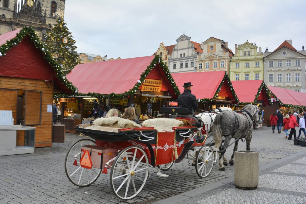Prague, Christmas market on the old town square and traditional horse and coach