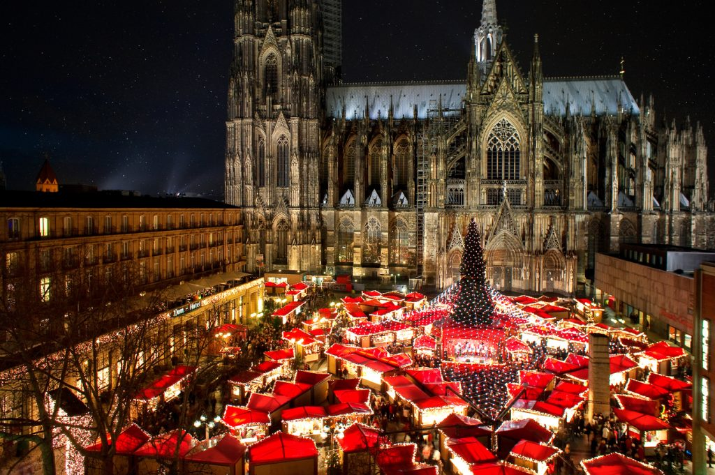 Panorama view of Cologne cathedral christmas market with world heritage site cologne cathedral at night.