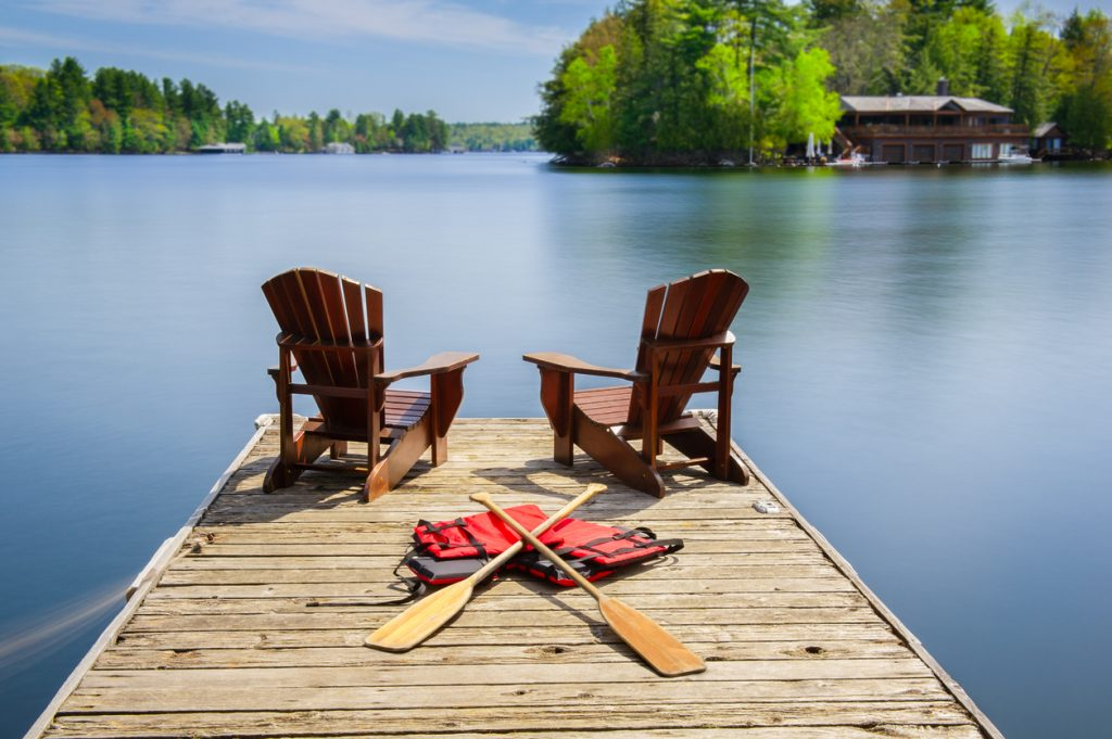 Muskoka chairs on a wooden dock