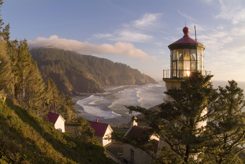 The Light from Heceta Head Lighthouse sends Beam from its First Order Fresnel Lens across the Coast. A Fully Operational Lighthouse operated by Oregon State Parks and Coast Guard.