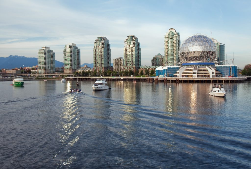 View of the Vancouver skyline of Science World and nearby buildings from the water of False Creek