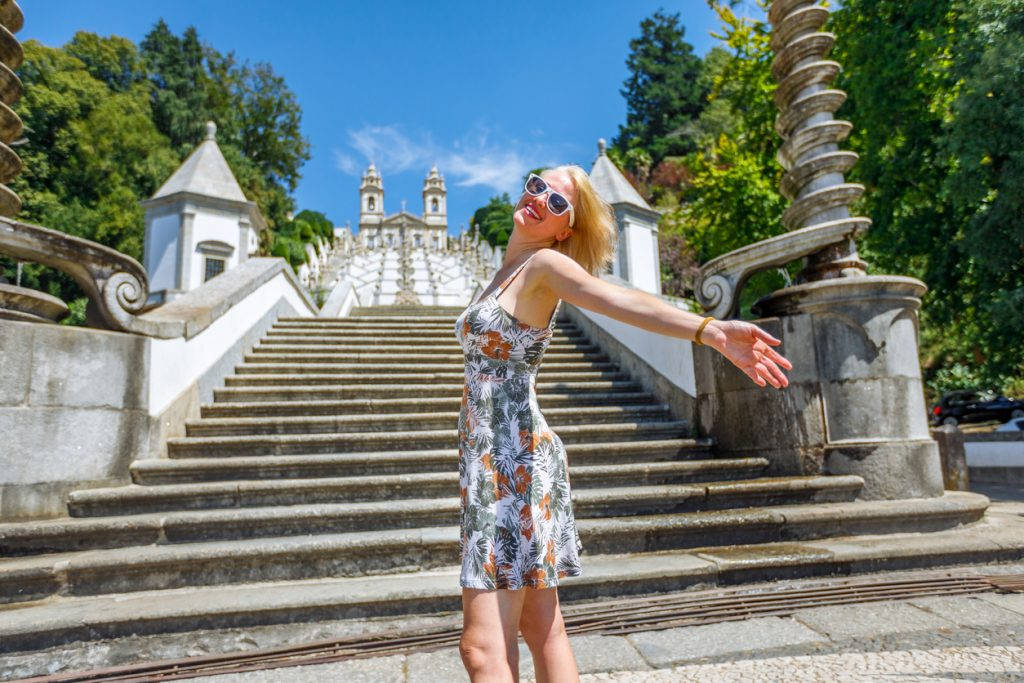 Open arms at baroque monumetal stairway of Bom Jesus do Monte Basilica.