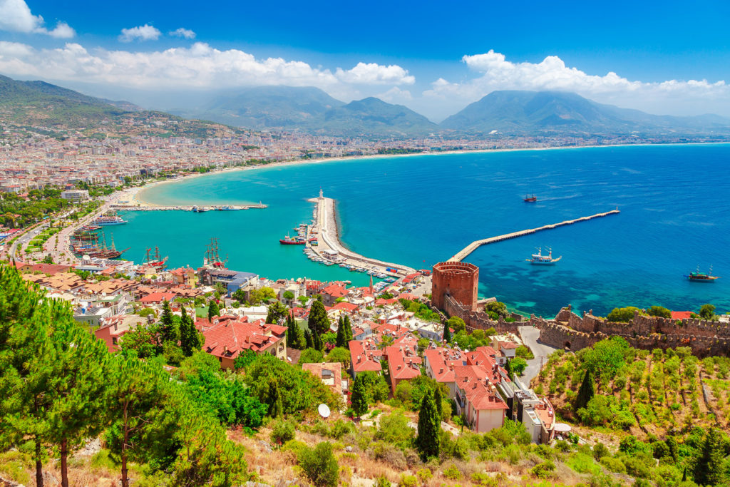 The landscape of Alanya with marina and Kizil Kule red tower in Antalya district, Turkey