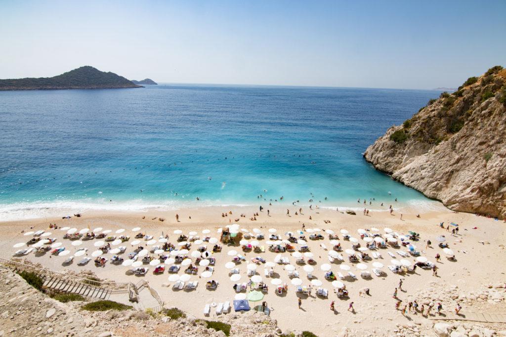 Tourists sunbathing and swimming on the Kaputas Beach, Kas, in Turkey