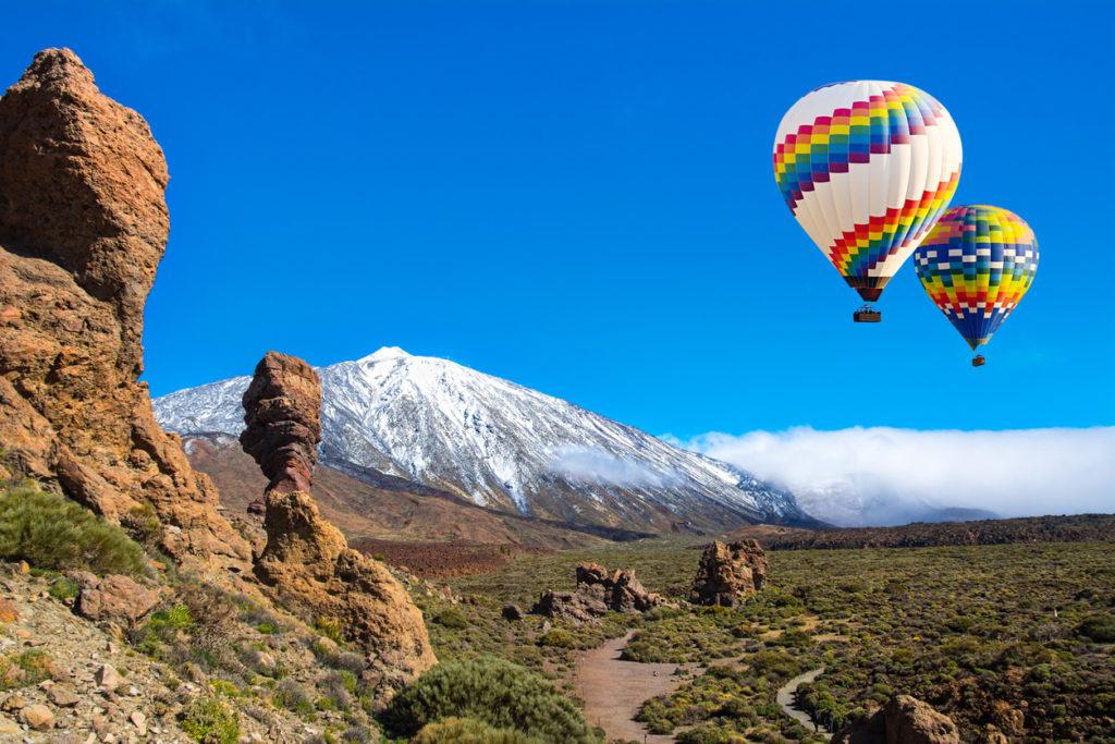 Beautiful view of unique Roque Cinchado unique rock formation with famous volcano Mount Teide