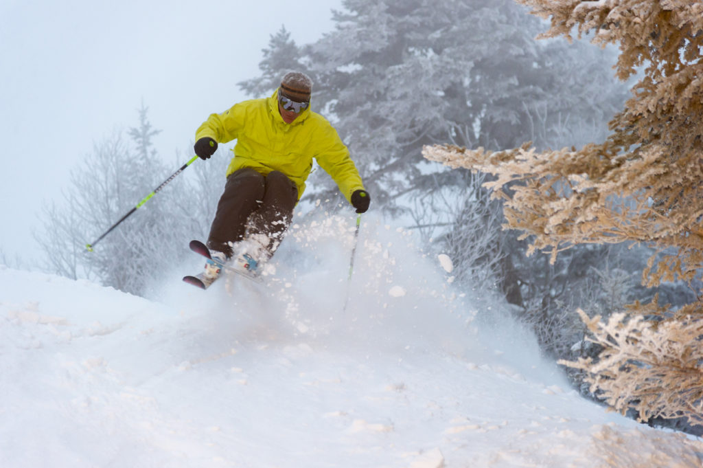 An expert skier on a powder morning, Stowe, Vermont