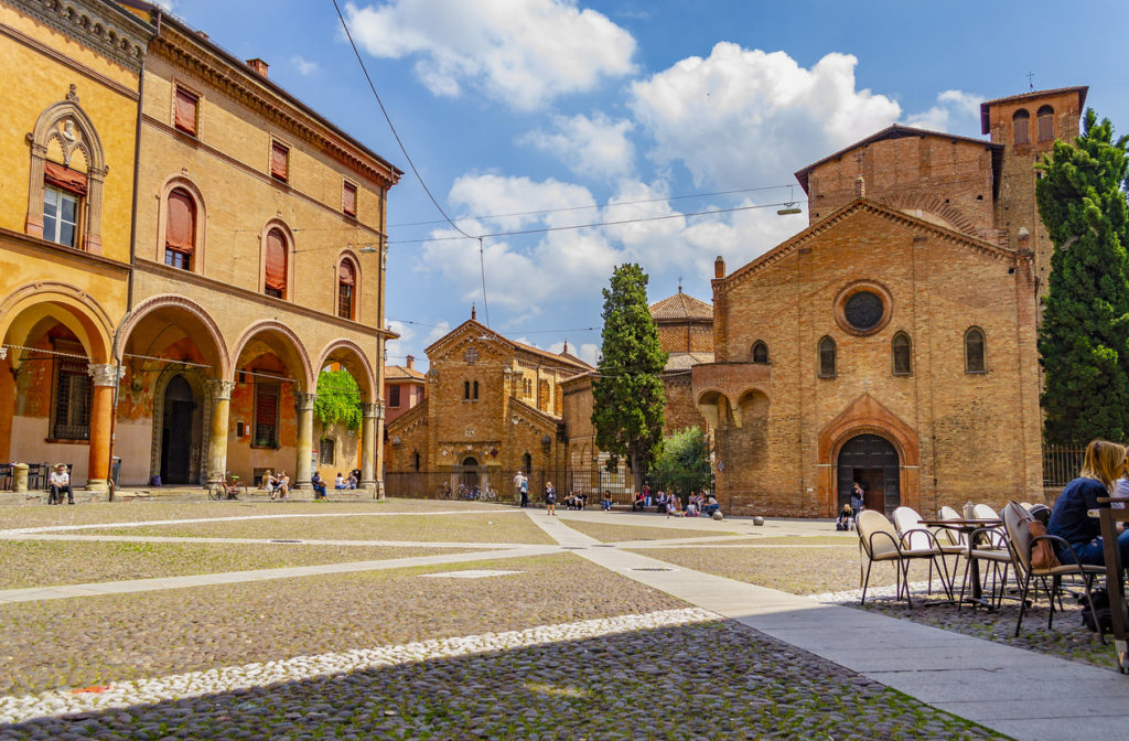Piazza Santo Stefano, also called Piazza delle Sette Chiese, and the Basilica of Santo Stefano in Romanesque and Italian Gothic style.