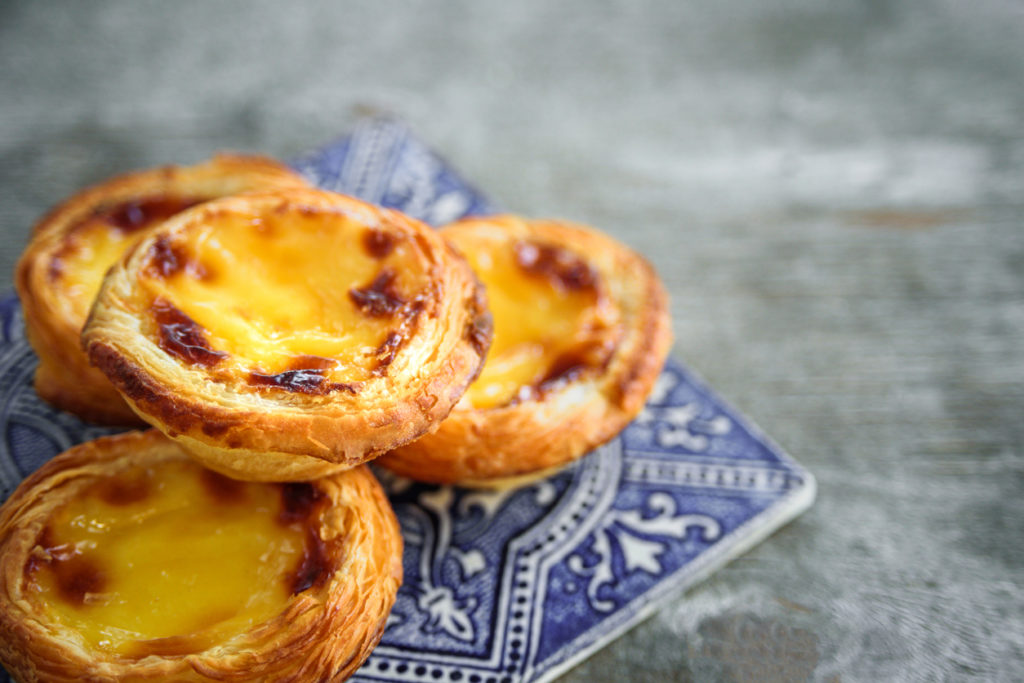 Portugal egg tart Pastel de Nata with an Azulejo tile plate