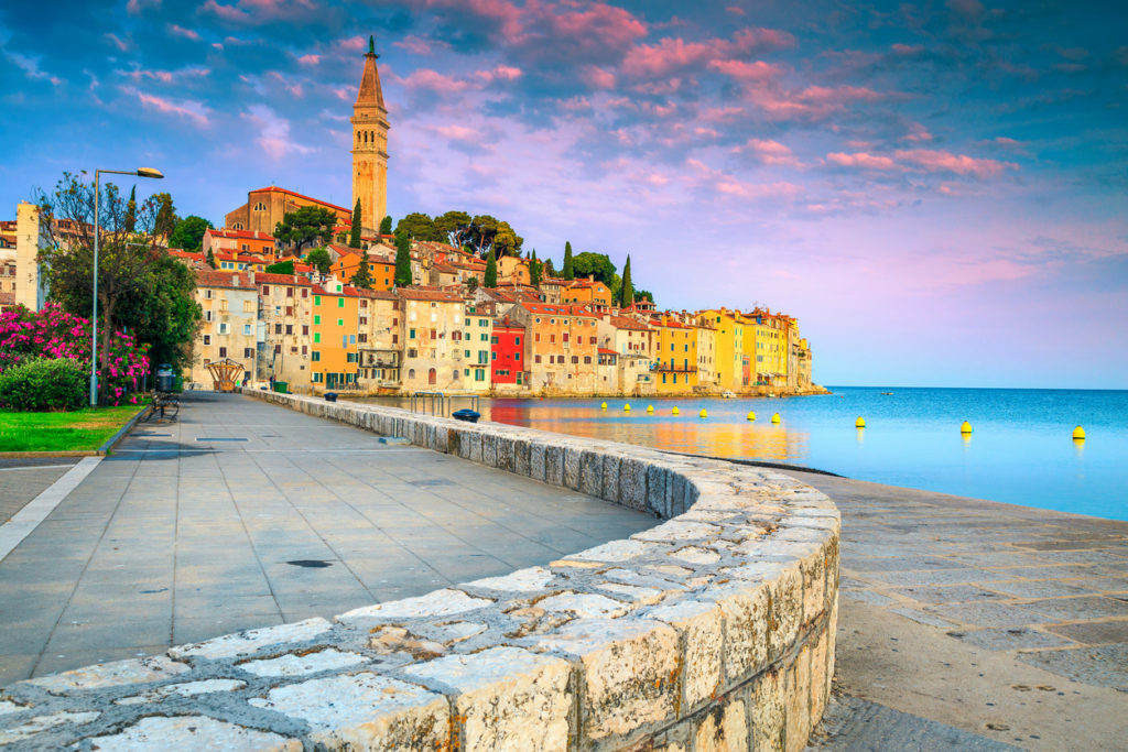 Rovinj harbor and old town with colorful buildings at sunrise