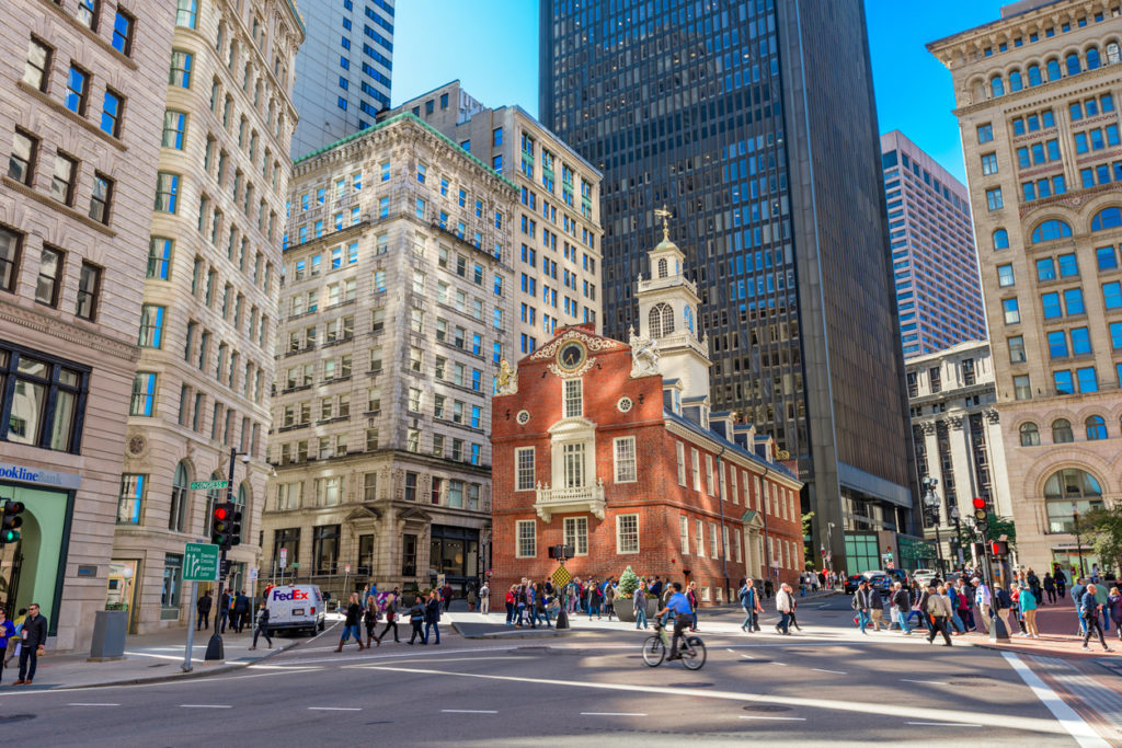 Pedestrians cross at the Old State House in Boston. The building dates from 1713.