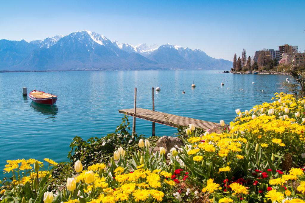 Flowers, mountains and jetty on Lake Geneva, Montreux, Switzerland