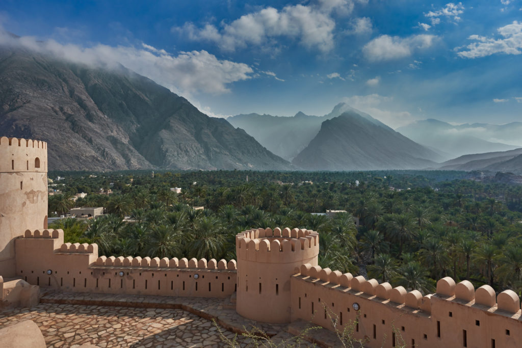 View of mountains and date palms in Oman