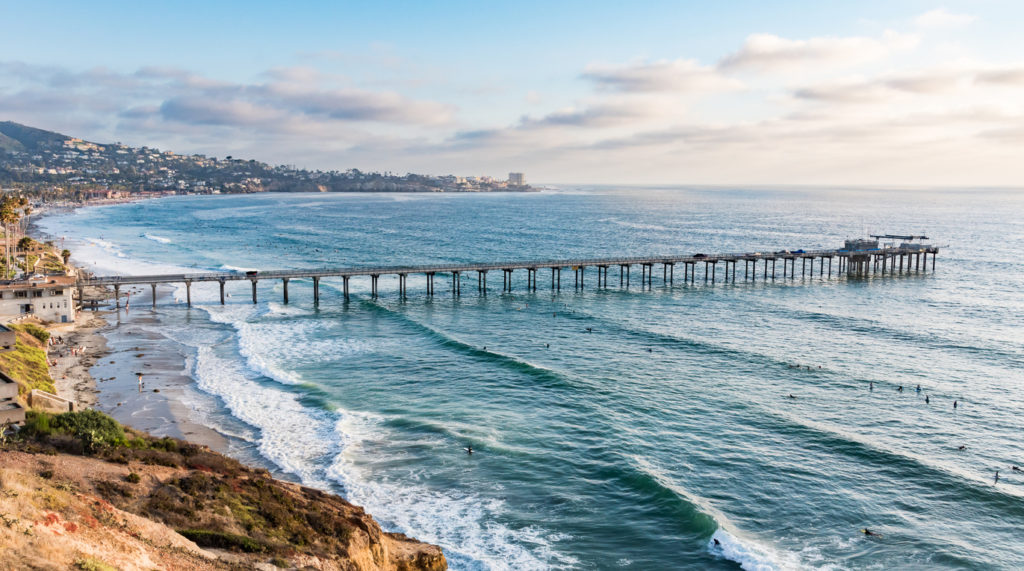 Scripps Pier just before sunset with the La Jolla Cove in the background
