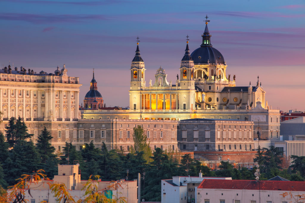 Madrid skyline with Santa Maria la Real de La Almudena Cathedral and the Royal Palace during sunset
