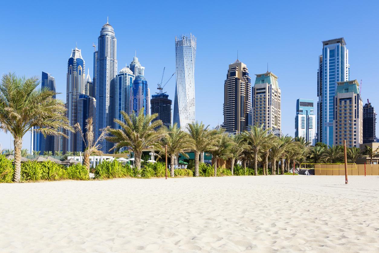 Horizontal view of skyscrapers and jumeirah beach in Dubai. UAE
