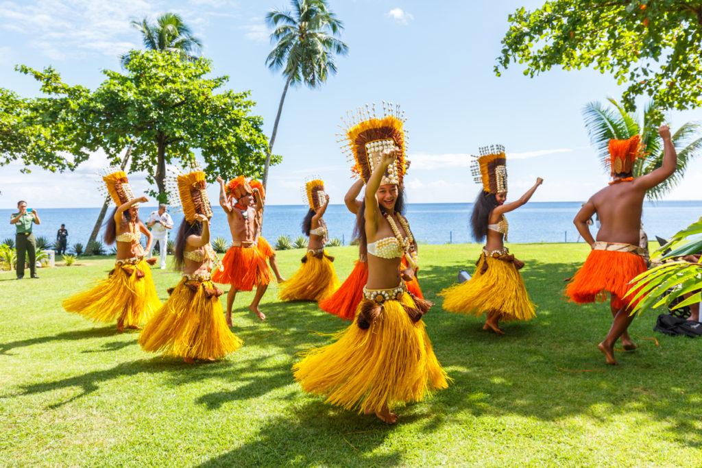 Polynesian women perform traditional dance in Tahiti Papeete, French Polynesia. Polynesian dances are major tourist attraction of luxury resorts of French Polynesia
