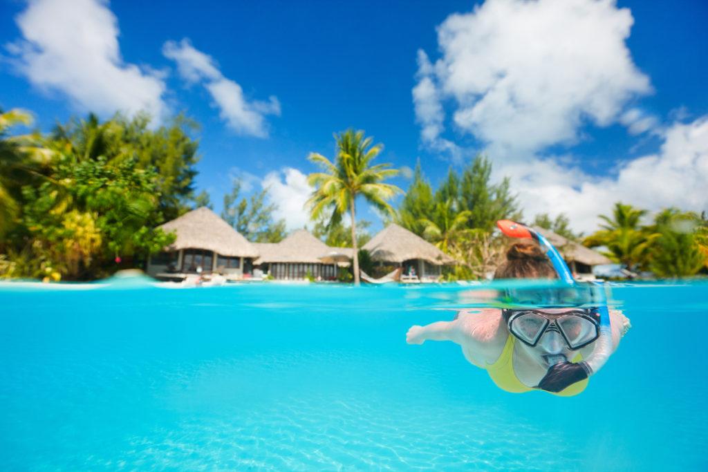 Woman snorkeling in Tahiti
