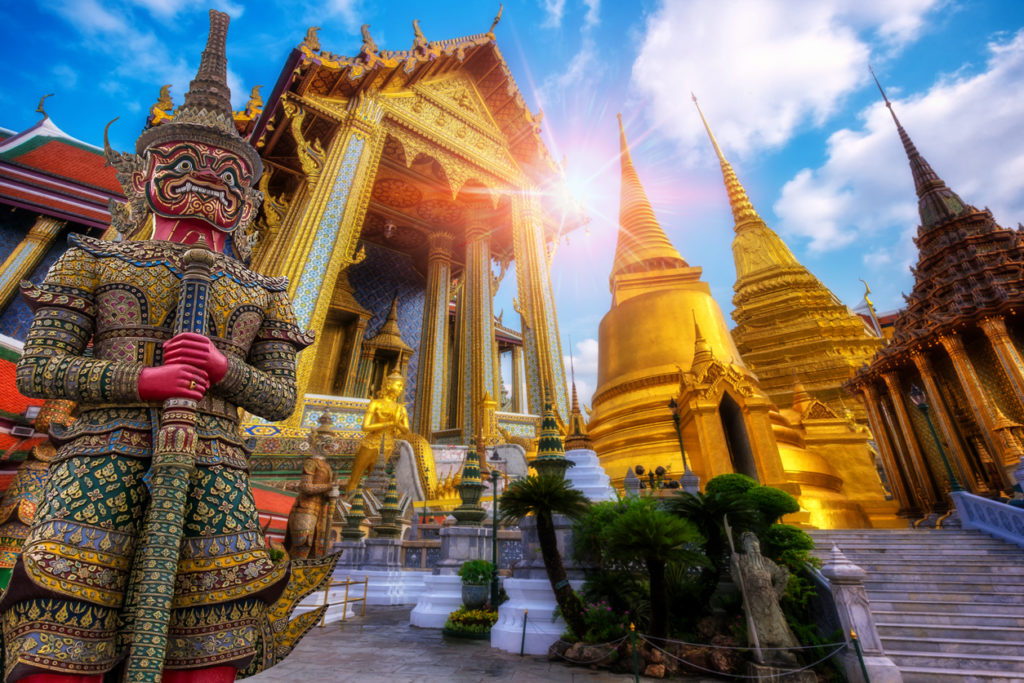 Travel concept, Giant statue at Temple Wat Pra Kaew, Grand Palace, Bangkok Thailand
