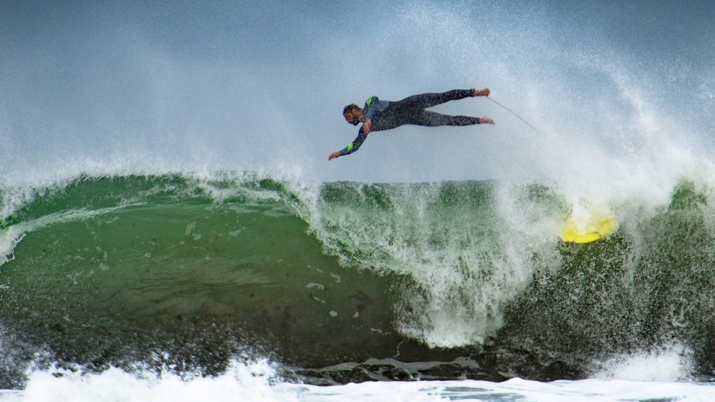 Surfing the powerful waves in Peniche, Portugal
