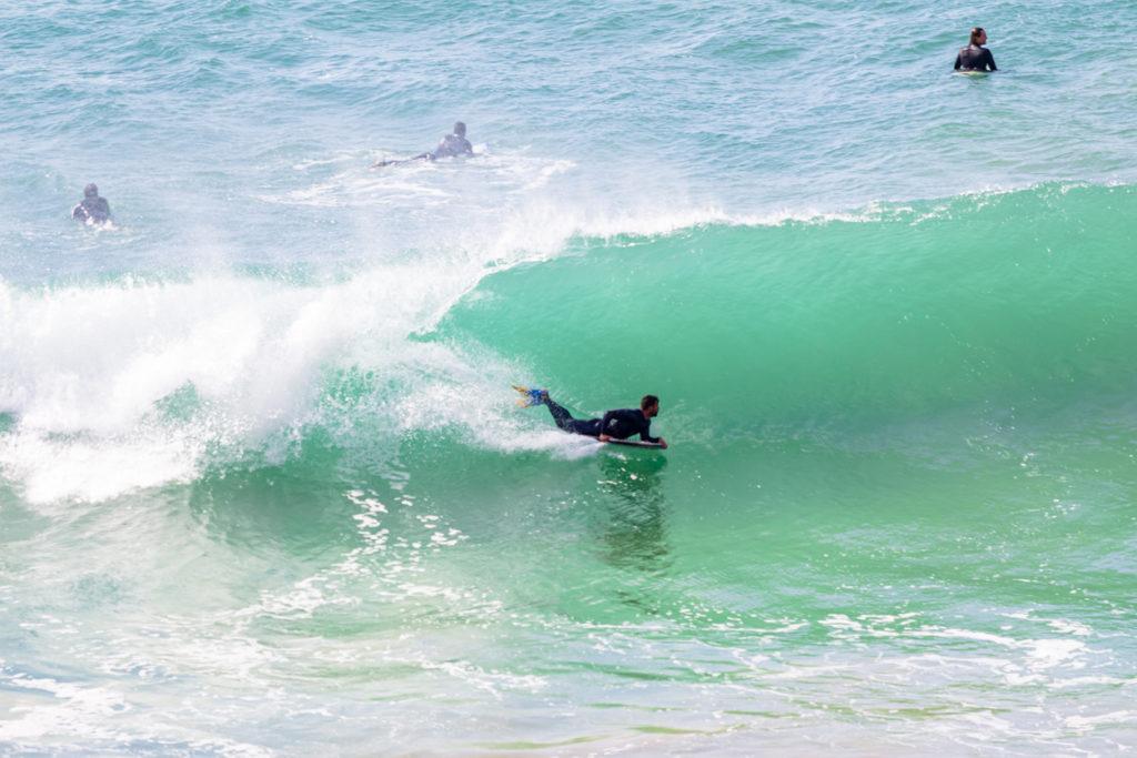 Surfers at Beliche Beach