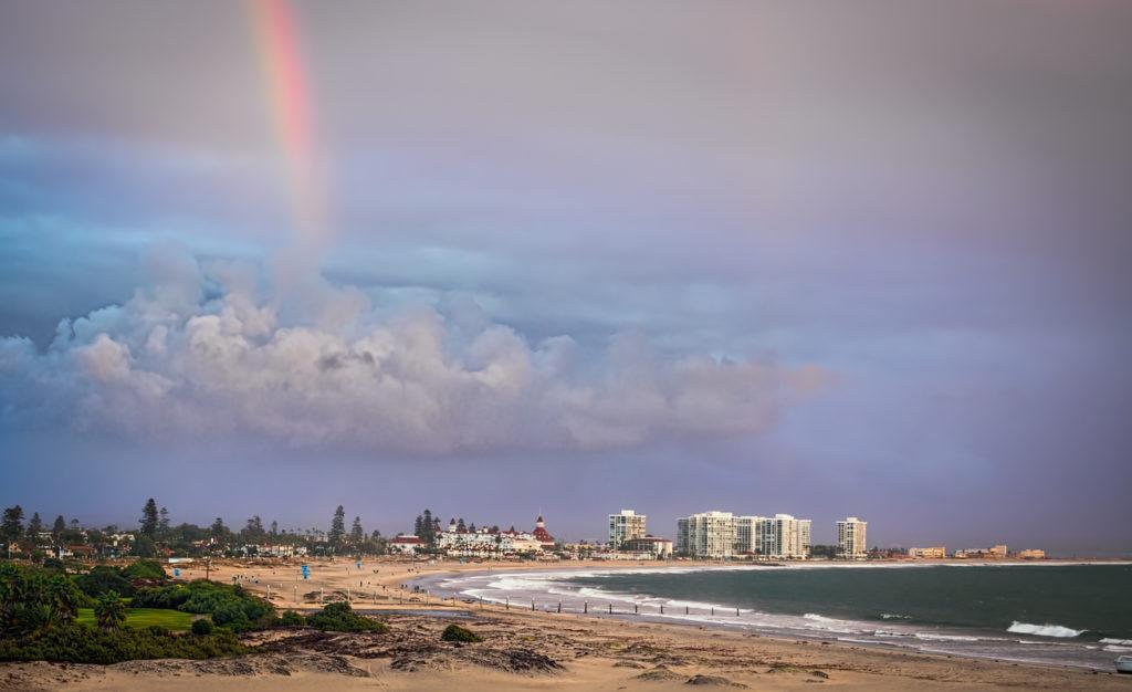 A rainbow appears over the small seaside town of Coronado, California.