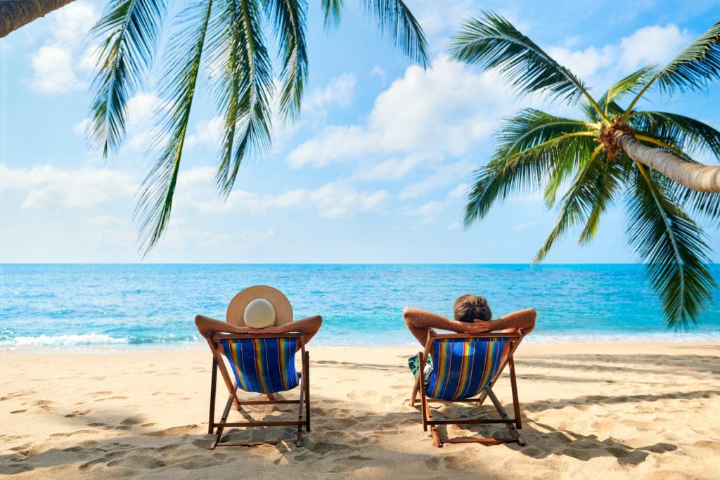 Couple relax on the beach enjoy the beautiful sea on the tropical island