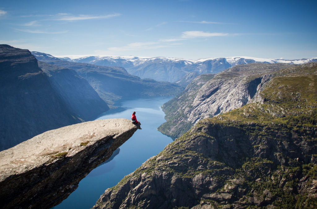 Trolltunga rock above the fjord.
