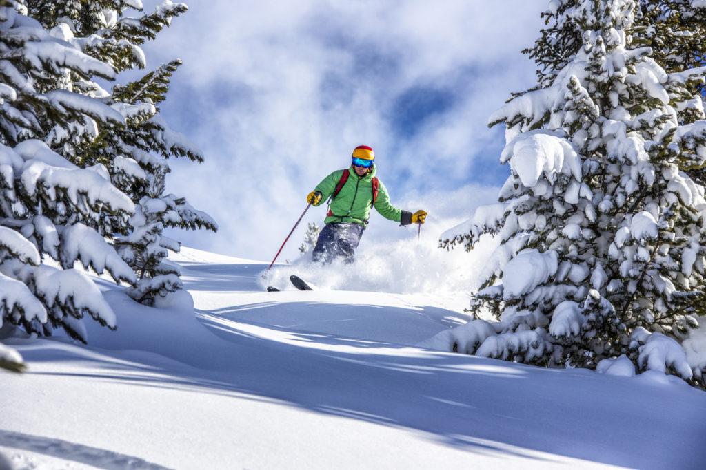 Skiing through trees in St Johann