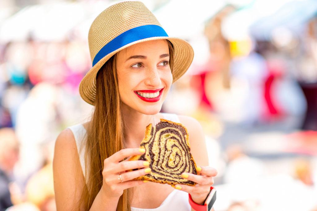 Woman eating traditional slovenian dessert