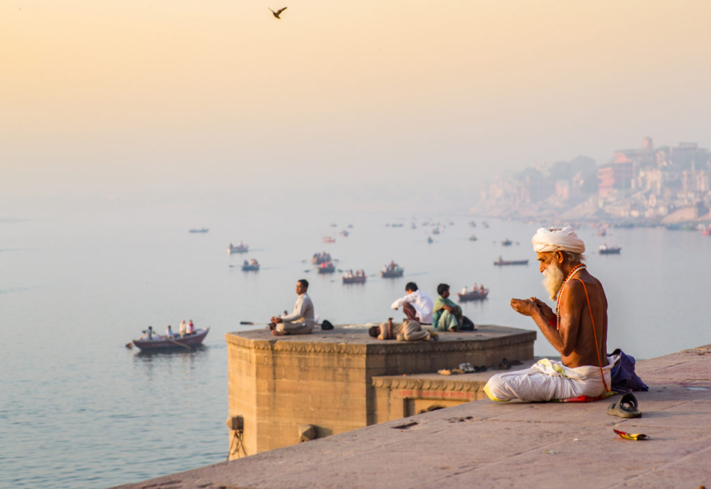 morning prayer by the river Ganges in Varanasi, India