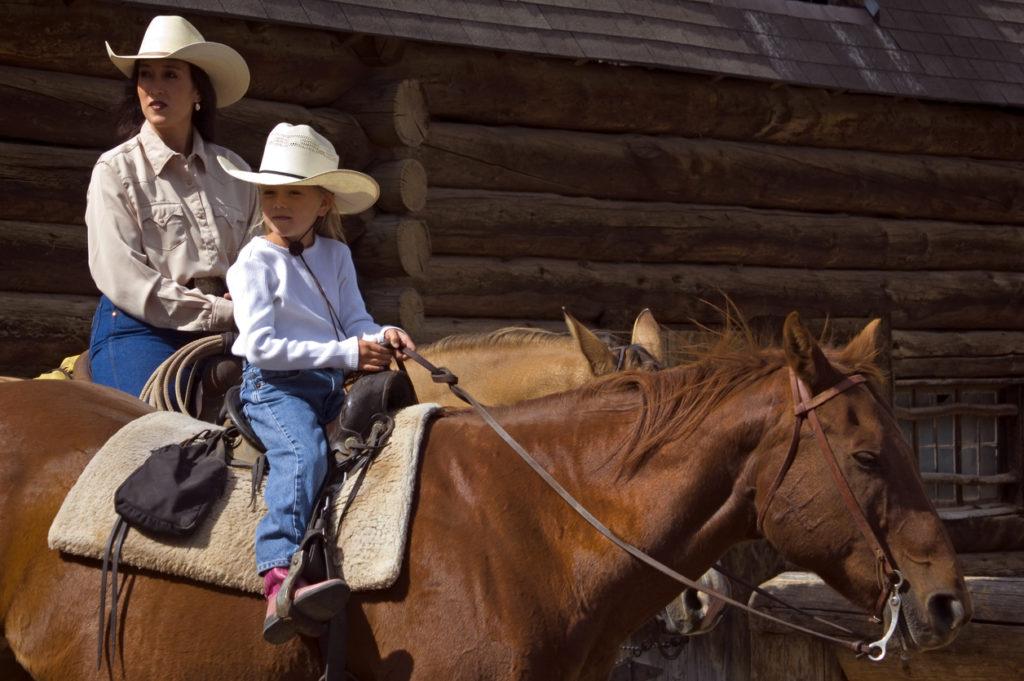 Horseback Mother and Daughter in Montana