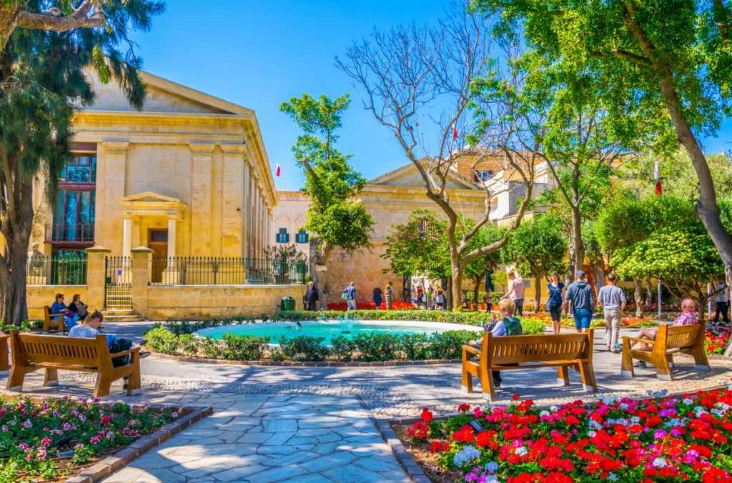 People are enjoying shade in the upper barrakka gardens in Valletta, Malta