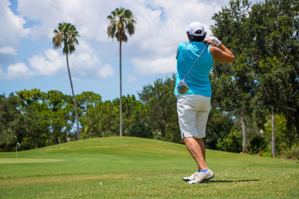 Golfer Hitting Ball on Beautiful Golf Course
