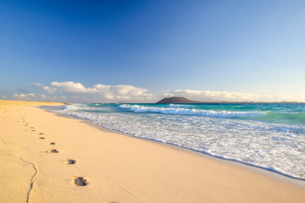 Stunning morning view of the islands of Lobos and Lanzarote seen from Corralejo Beach