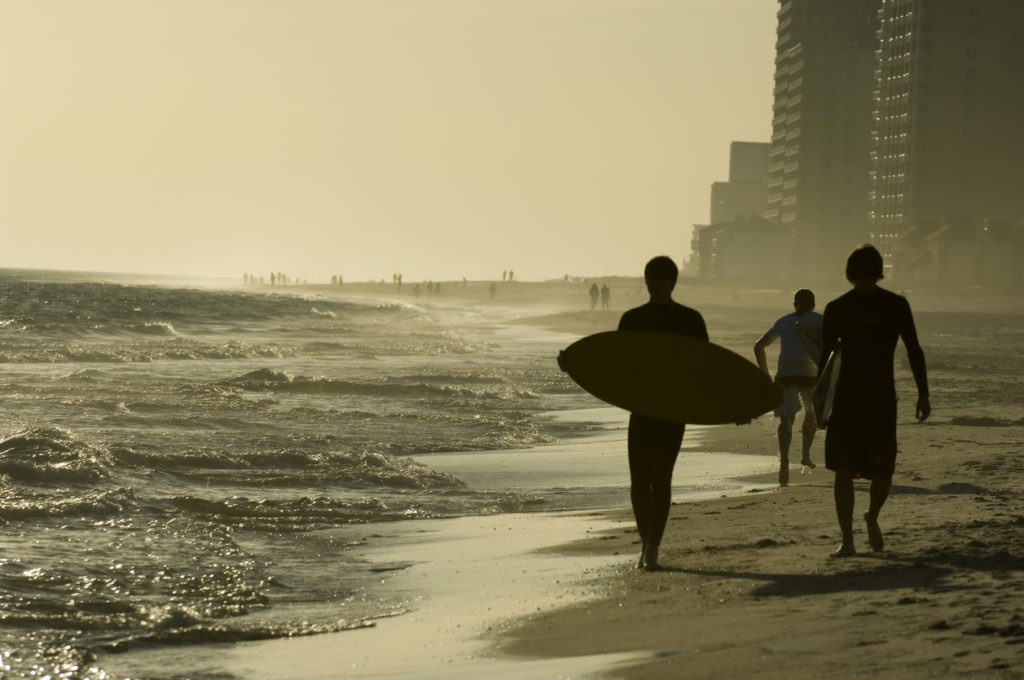Surfers on the beach at Gulf Shores