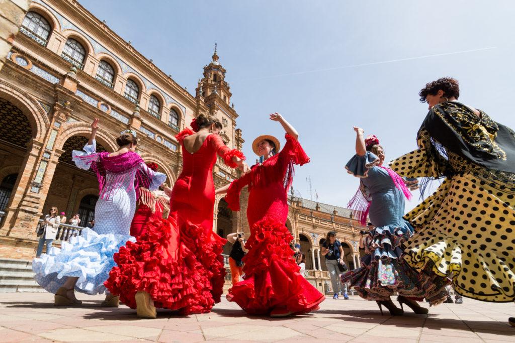 women dance flamenco on Plaza de Espana in Seville, Spain