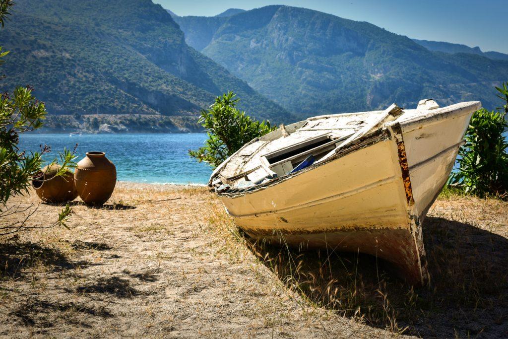 Abandoned boat on a sandy beach in Oludeniz Turkey