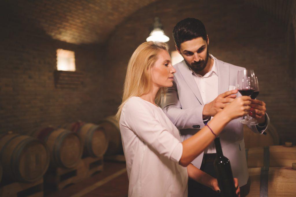 Tasting wine in winery basement