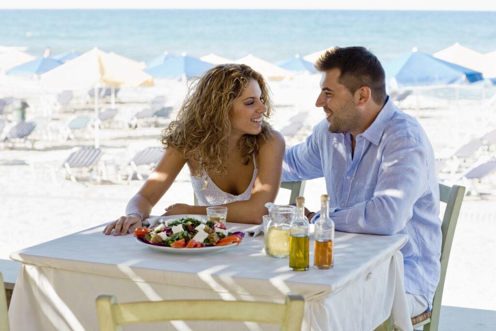 Enjoying Greek food on the beach