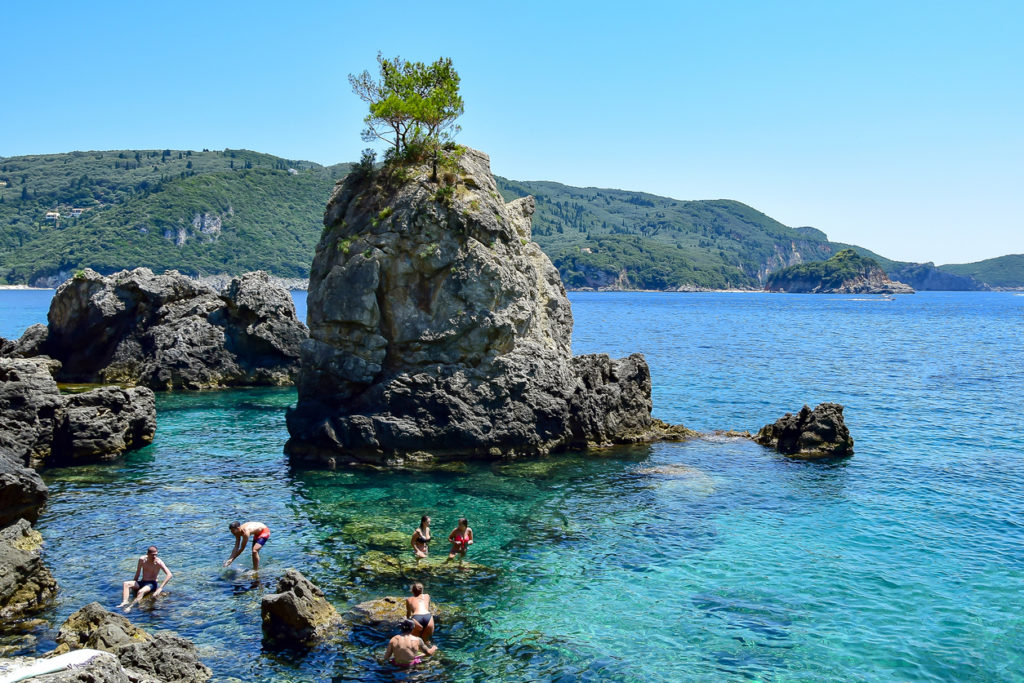 A Magestic rock with a tree in the bay in Corfu