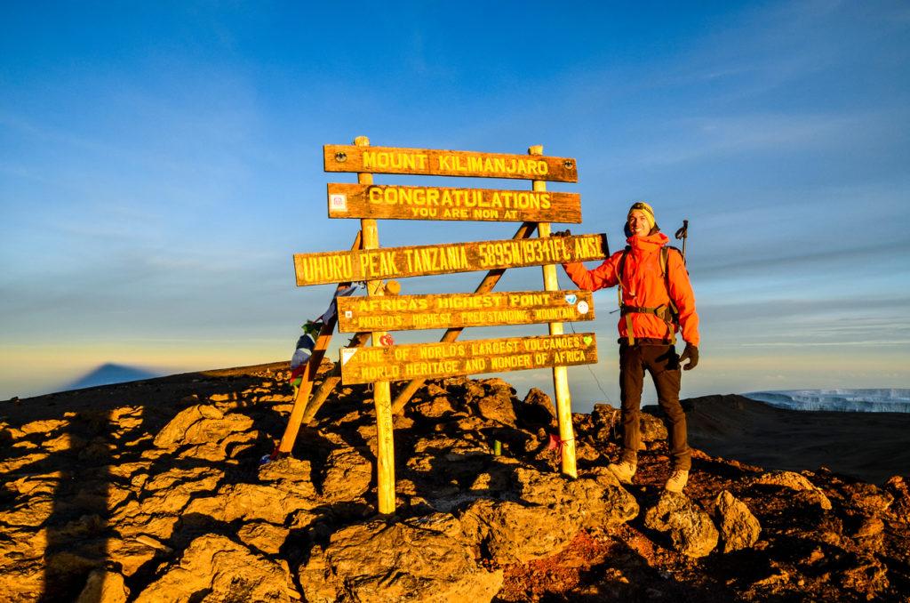 Hiker at Uhuru Peak, Kilimanjaro - Tanzania, Africa