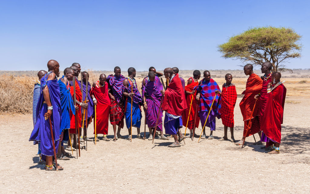 Massai men in colorful cloth in a Massai village, Tanzania