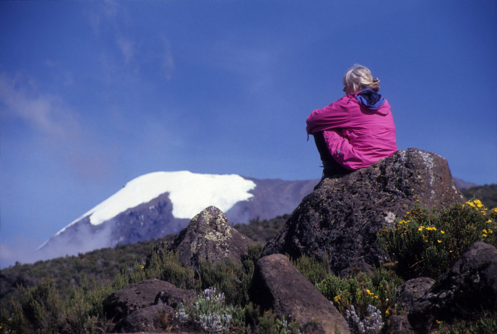 Tourist watching Mount Kilimanjaro the highest point in Africa,