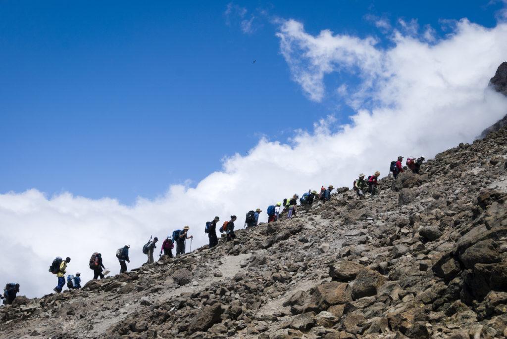 Trekkers arriving at Base Camp, Mt Kilimanjaro, Tanzania