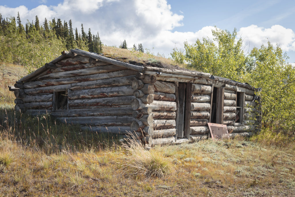 Old abandoned cabin, in city of Champagne in Yukon
