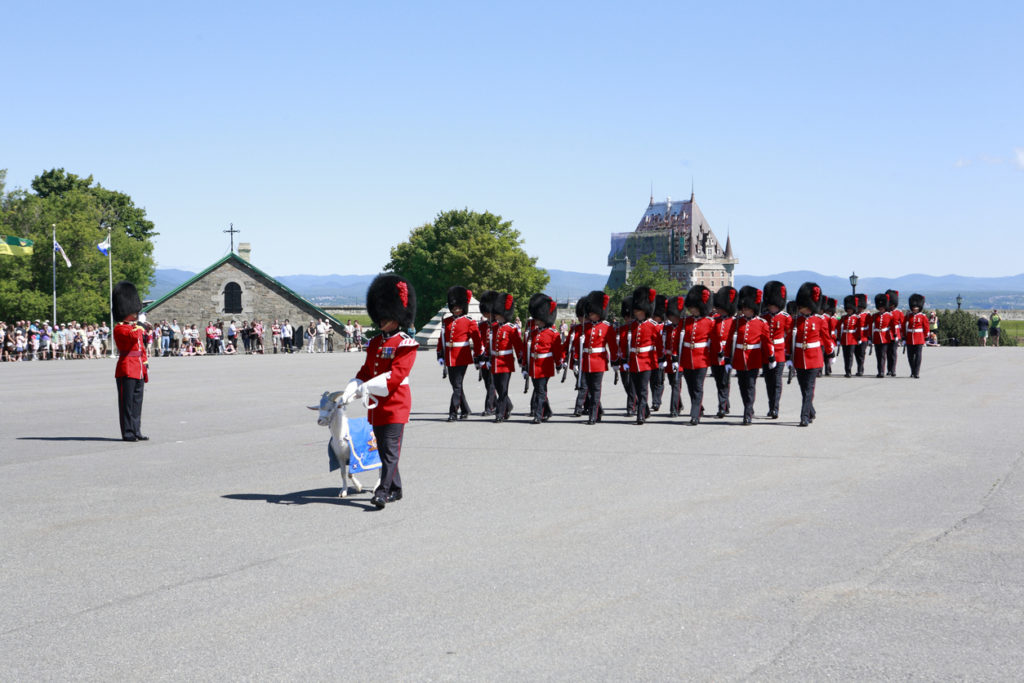 he Canadian soldiers from Royal 22e Regiment are having the traditional Changing of Guard ceremony in the historical La Citadelle